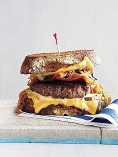 "Boston boy Paul Wahlberg (brother of Mark) presents a juicy burger flanked by gooey slices of cheese. It's ""wicked good"" thanks to its ""flavor combo,"" says the chef-owner of Boston eatery Wahlburgers. http://www.people.com/people/gallery/0,,20701250,00.html"