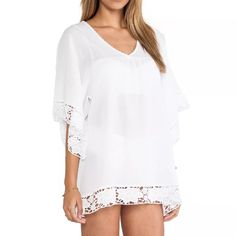 Bikini cover up One size fits all.    Measurements:              Lenght  - 32 inch (82 cm).                              Bust - 45 inch (115cm).  Hips 52 inch( 132cm).   Sleeves- 14 inch (35cm). Swim Coverups