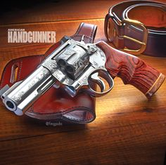"Dave Lauck's hard-chrome Model 29, 4"" bbl, .44magnum Loading that magazine is a pain! Get your Magazine speedloader today! http://www.amazon.com/shops/raeind"