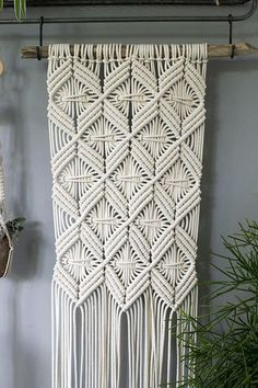 A beautiful bohemian inspired handmade macrame wall hanging. Use this decorative wall hanging to add a handmade touch to your home, office or cabin. I first started experimenting with making macrame wall hangings last year, when I made a few wall hangings for myself and friends. I love to design my new wall hangings, choosing my new piece of driftwood and combine it with the right geometrical shape. Ready to ship Product details: 100% cotton 5mm braided cotton rope on handpicked Dutch…