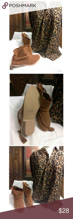 🍒Rue 21🍒 Brown Suede Ankle Boots sz M 7-8 Brand new, never worn suede boots with tassle tie design. They boast geo horizontal cutouts at the sides of the foot. Complete with a stacked heel.  Heel height: 2 in.Non-skid sole. Man-made materials Rue 21 Shoes Ankle Boots & Booties