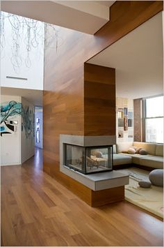 wood paneling vs. stone for double sided fireplace