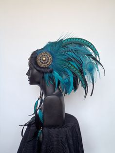 RESERVED Midsize Teal & Black Warrior Headpiece Headdress. $385.00, via Etsy.