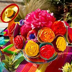 Create a Fiesta cupcake bouquet that features rose cupcake frosting and tissue paper flowers. It's the perfect Cinco de Mayo party centerpiece idea. Mexican Fiesta Party, Fiesta Theme Party, Party Themes, Party Ideas, Theme Parties, Birthday Parties, Cakes Originales, Cupcake Centerpieces, Mexican Independence Day