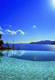 Greece, Santorini, Infinity Pool Overlooking Aegean Sea by Luca Trovato on Getty