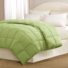 """Main Street Brighton Comforter - Green Frond - Full/Queen by Main Street. $49.99. Set Includes: Comforter. Sleep in comfort with this casual, solid comforter. The fabric is all cotton on both the front and. Size: Full/Queen: 90x94"""". Material: Cotton. Patten: Solid. Sleep in comfort with this casual, solid comforter. The fabric is all cotton on both the front and reverse. The comforter is overfilled with down alternative fill, giving it warmth and a super soft feeli..."""