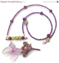 Purple crystal beaded bar necklace. seed beaded necklace with polymer clay beads and copper. $25.90 USD, via Etsy.