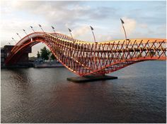 Anaconda or Python Bridge. Designed by architecture firm West 8, the bridge was built in 2001 and is known as the Anaconda or Python Bridge. It won the International Footbridge Award in 2002. Amsterdam