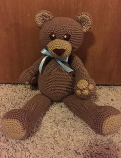 Dawson the bear stands about 18 inches tall, sitting is about 12 inches.