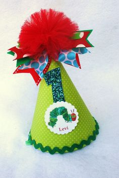 Very Hungry Caterpillar birthday party hat in pistachio, teal, red, green and aqua polka dot. $14.50, via Etsy.