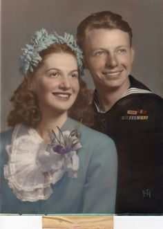 Wedding photo June, 1945 ... elaborate weddings were not the norm right after the war. Even my parents had a more intimate wedding with family and very few close friends.....mom wore a blue skirt suit very similar in color as this pretty lady's and dad wore his RCAF uniform.