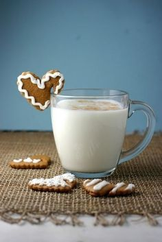 Unbearably precious. Iced gingerbread hearts perched on the edge of a glass.