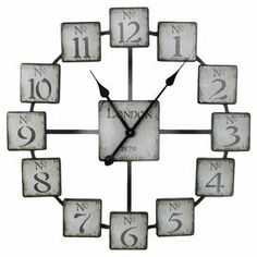 """Metal wall clock with an openwork design.  Product: ClockConstruction Material: MetalColor: Black and grayAccommodates: Batteries - not includedDimensions: 23.6"""" Diameter x 1.7"""" D"""