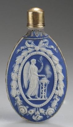 "IMAGE: English jasperware blue-ground scent flask, possibly Wedgwood or Turner, 1790 to 1800. Applied in white relief within a ribbon-tied wreath on one side with a sacrifice and on the other with ""Venus and Cupid"""