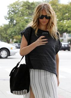"""Jennifer Lawrence wears Alexander Wand Bucket Bag Photo: Purse Blog Let's face it, if JLaw is a fan, then so are we!Harper's Bazaarhails the """"Bucket Bag"""" as one of the """"It"""" bags for 2015, and with celebrities such as Jennifer Lawrence toting it around, it's no wonder everyone's rushing out to pick one up.  In short, we love it! Photo: Life and Style Photo: Life and Style Or perhaps, metallics are your thing! In that case, A Pair and a Spare has got you covered."""
