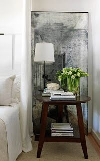 Overscale Hand-Antiqued Mirror Tutorial....or how to antique any mirror.  This would be a great project as a focal wall (headboard) in a small bedroom to give the illusion of space and to reflect natural light, making a smal room feel bigger.  You can adhere the mirror tiles to the wall and trim with molding (or simply mirror the whole wall), or create it the size you want it and trim it out.