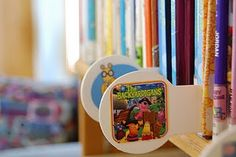 Shelf markers...  Modge podge the book cover to a shelf marker to indicate where a series is
