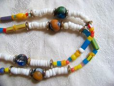 Glass beaded necklace, Venetian colored beads. Necklace is long, beads are pretty, can double. My Etsy shop: www/etsy.com/shop/walkingwithjulann