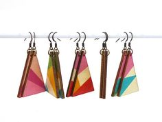 Make a unique statement with these pretty colorblocked triangle earrings! Lightweight laser-cut wood is printed with geometric patterns and