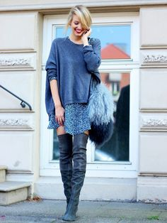 Ohh Couture blogger wears trendy thigh-high boots with casual sweater and feathered purse