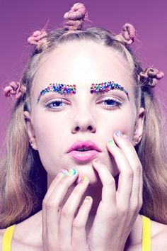 Place colorful rhinestones on your eyebrows to give yourself a candy-coated NYE makeup look.