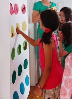 This interactive punch wall looks just like a strip of candy buttons. It borrows a page from The Price Is Right, where contestants have been playing Punch A Bunch since the 1970s, only Maddie's guests played for favors instead of cash prizes.
