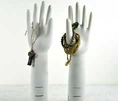 LOVE these jewelry displays, vintage glove displays.