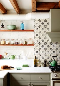 Floral tile backsplash in white kitchen