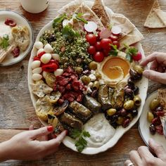 Mezze Platter: a combination of artichoke hearts, marinated garlic, feta, pesto, olives, tabouli, hummus, tzatziki, and dolmades.