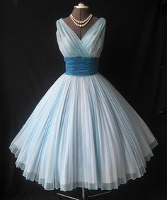 Baby blue dress with darker blue sash--pleated and crossed top