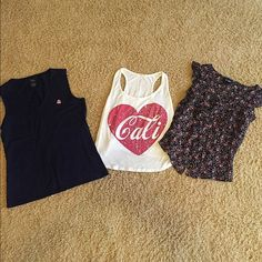 CLEARANCE!!! 3 Tank Lot What a deal. Price is for all together. The Cali tank is a little faded, better fit for working out or beach days! The left is a navy blue tank and right is black with floral print. ✳️make an offer!  ✳️bundle for extra savings! ✳️ask me to check out your closet/trade! Tops Tank Tops