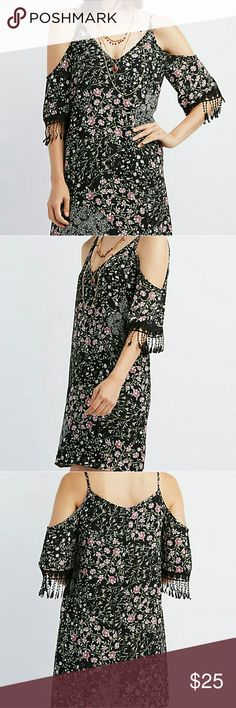 Floral Shift Dress Floral open shoulder shift dress is 100% polyester has an extra lining that is also 100% polyester this is a mini dress get ready for the great weather ahead ladies bundle two items and receive a discount Dresses