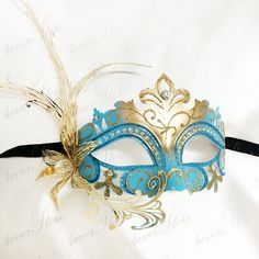Hey, I found this really awesome Etsy listing at https://www.etsy.com/listing/190265636/teal-gold-venetian-masquerade-mask-metal
