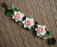 Crochet Bracelet pink white Daffodil flowers-This reminds me of something my grandmother gave me when I was little. Made from cashmere yarn with 3 shades of green for the leaves, pink and white with yellow centers for the flowers Crochet Crafts, Crochet Yarn, Crochet Stitches, Crochet Projects, Crochet Patterns, Crochet Bracelet Tutorial, Knit Bracelet, Flower Bracelet, Wrap Bracelets