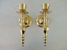 Elegant Hollywood Style Pair of Brass Wall Candle Sconces Beautiful Detail and Condition. $32.99, via Etsy.