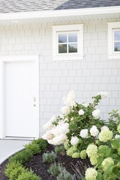Tori Wesszer's exterior house reveal - how to choose a grey house colour for shakes.