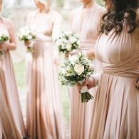 Seriously considering these...Two Birds bridesmaids dresses in blush. Two sizes, no alterations and let the girls choose which style they want to wear...hmmm...