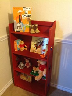 Texas Cowboy Nursery - Another Craigslist find! This sweet little bookcase was transformed with Annie Sloan chalk paint. What we loved the most about this bookcase was the cut-out stars which adorn the sides of each shelf. Momma-to-be painted the stars blue to add texture and depth to the bookcase! Books were purchased on Amazon; little baby cowboy boots were purchased at Cracker Barrel by Great Grandmother; and our little cowboy's Daddy purchased the Winnie the Poo plush at the Disney…