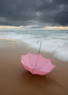 Pink umbrella on the beach...