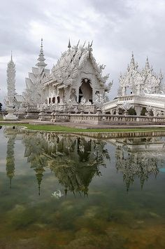 Reflections of Wat Rong Khun in Chiang Rai, Thailand