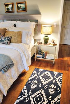 window headboard, cute and functional side table, and love the colour of the floors - great sleeping space.