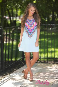 You'll be dreaming of wearing this gorgeous dress all day long! Featuring a vibrant multicolor pattern with neon pink, orange, yellow, green, light blue, purple, black, and white, the bold colors are so perfect for summer!
