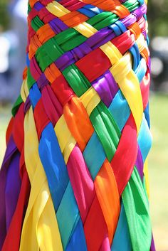 Brightly colored ribbons were woven around the pole by the dancers as they wove around eachother. This symbolizes the balance of masculine and feminine energies and the duality of life.