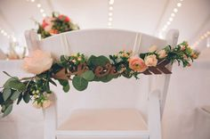 his and hers wooden bride and groom chair decoration. Wedding tent reception at Highland Springs Resort.  Chaffin Cade Photography. Peach roses and eucalyptus spray