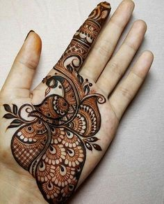 Check out the 60 simple and easy mehndi designs which will work for all occasions. These latest mehandi designs include the simple mehandi design as well as jewellery mehndi design. Getting an easy mehendi design works nicely for beginners. Henna Hand Designs, Mehndi Designs Finger, Peacock Mehndi Designs, Latest Arabic Mehndi Designs, Full Hand Mehndi Designs, Mehndi Designs For Girls, Mehndi Designs For Beginners, Mehndi Design Photos, Wedding Mehndi Designs