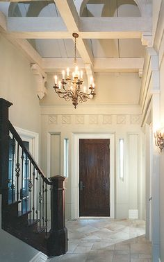 grand entrance with this ceiling treatment
