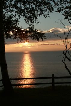 A Lake Michigan sunset!! Totally a God thing!!!! AWESOME!!!!!! right out by our house at the bluff!!