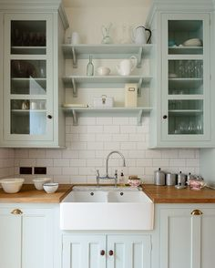 Sometimes galley kitchens can feel difficult to design as your options are limited, they are small and compact and need proper storage space. The warm colours and materials and glazed wall cupboards allow for extra light in the space, making it feel generously spacious and comfortable. Those shelves were a pretty good idea too via ✨ @padgram ✨(http://dl.padgram.com)