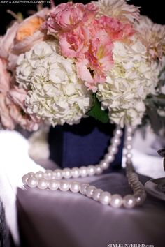 Elegant Wedding Table Decorated with Lace, Flowers, and Pearls