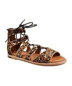 Ocelot Aubrey Leather Gladiator Sandal. . ..  Gee'WaWa $24.99 $136.00   : size chart. 6  . 7  . 8  . 9  . 10  .  Product Description:  These sandals feature a lace-up front and back zipper for an adjustable fit with an easy on and off, while the leather lining creates a soft, moisture-wicking interior.      Lace-up / back zipper closure      Cushioned leather footbed  .     Calf hair upper  .     Leather lining  .     Leather sole  .     Fur origin: Vietnam  .     Imported